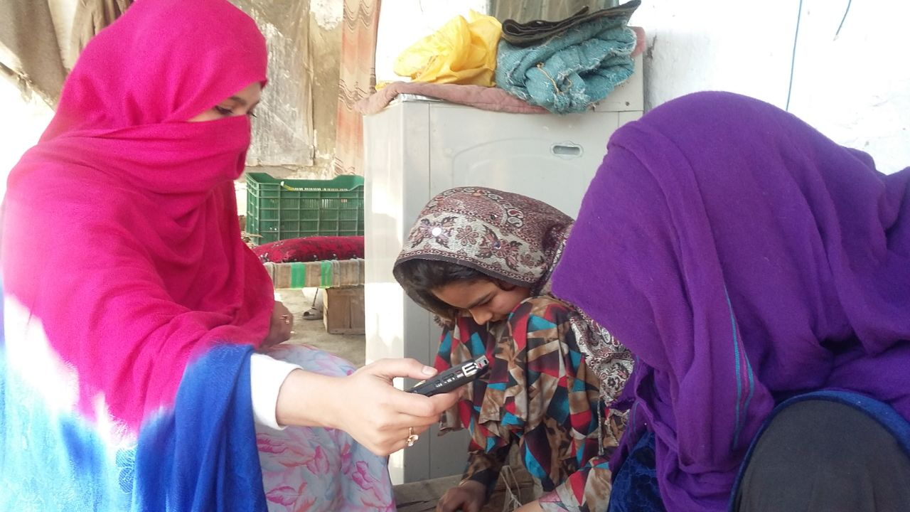 Saba is interviewing working afghan women in camp
