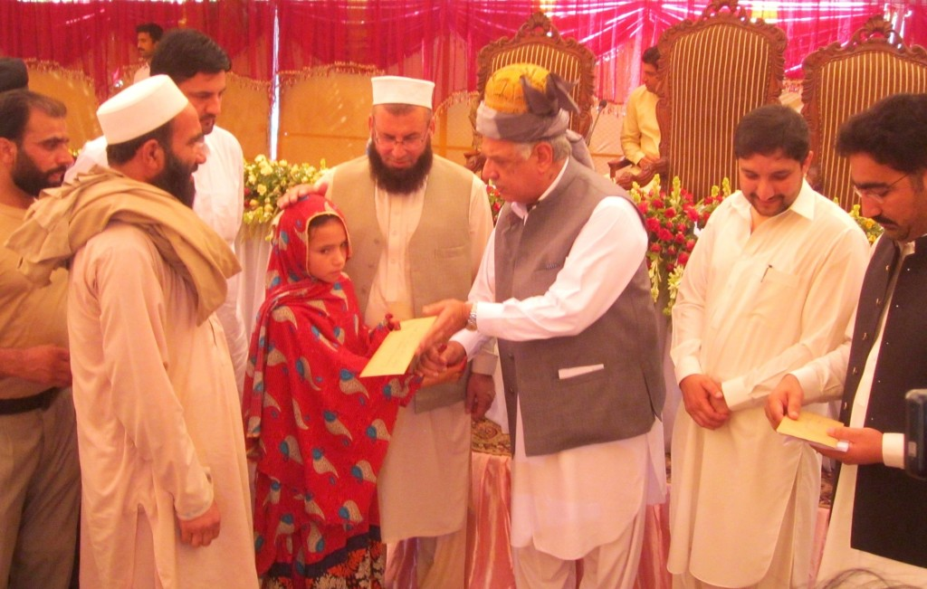 Governor Khyber Pakhtunkhwa Iqbal Zafar Jhagra giving away compensation cheques to the family members of terrorism victims in Khyber Agency. Photo by TNN