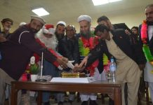 Allama Noorul Haq cut the Christmas cake at Jirga hall, Landi Kotal.