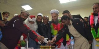 Allama Noorul Haq cut the Christmas cake at Jirga hall, Landi Kotal.