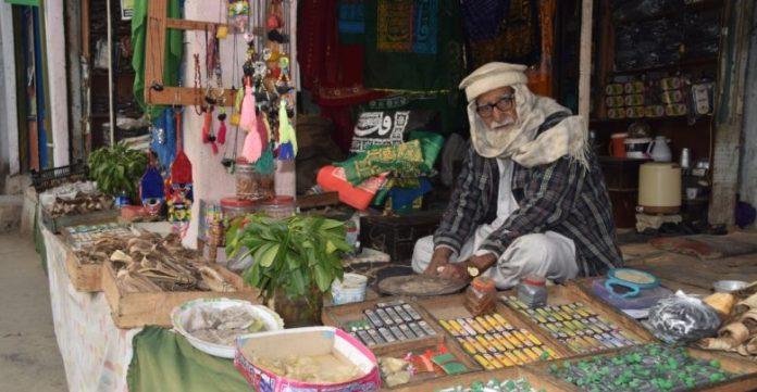 A road side vendor sells traditional cosmetics in Peshawar