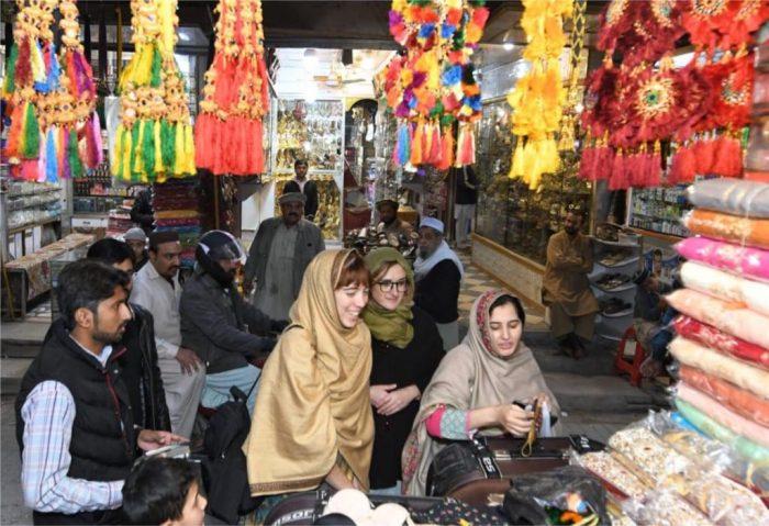 Italian Tourists purchase handicrafts in Meena Bazaar, Peshawar.