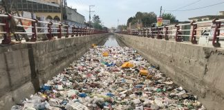 Plastic bags on the surface of irrigation canal in Gulbahar