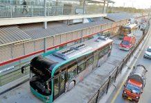 A bus crosses BRT Chamkani station during 'Test Run' on Friday