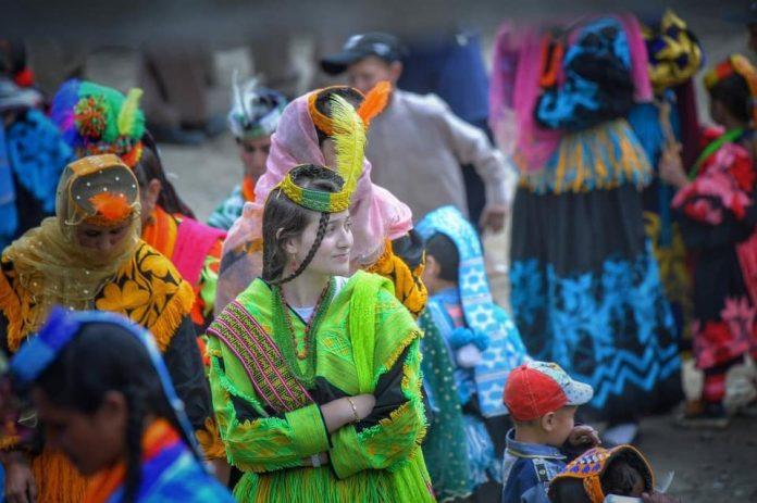 A girl cherish the religious Chelum Joshi festival in Chitral.