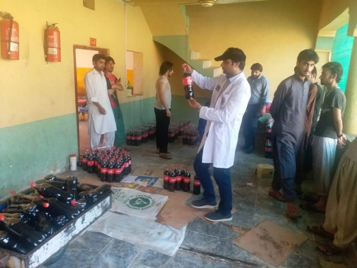 Officials of KP Food Authority examines Cold Drinks at factory in Nowshera